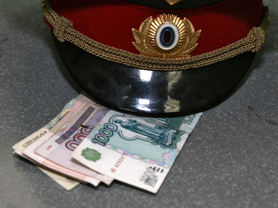 полицейский взяточник